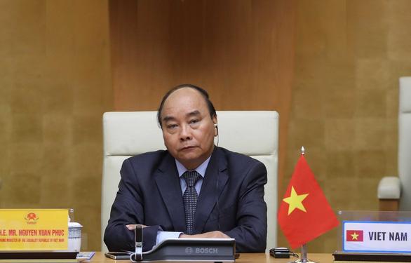 Thủ tướng dự Hội nghị thượng đỉnh trực tuyến G20 về COVID-19 - Ảnh 1.