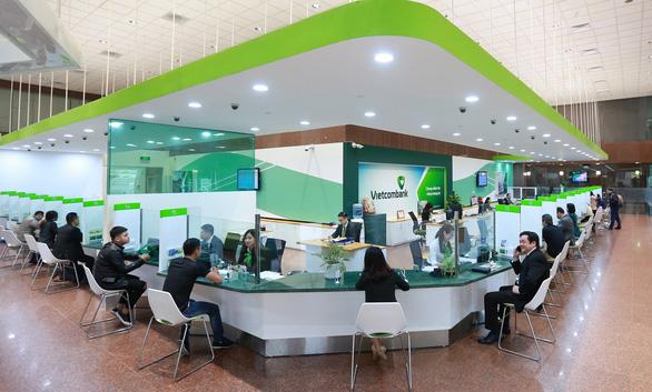 Vietcombank giảm phí dịch vụ chuyển tiền nhanh liên ngân hàng 24/7 - Ảnh 1.