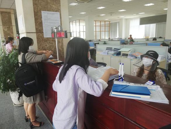 Hạn chế đông người nộp hồ sơ quyết toán thuế vì lo dịch COVID-19 - Ảnh 1.