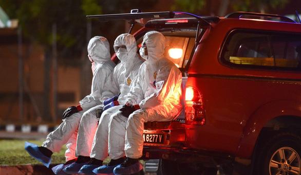 Vì sao nhân viên y tế Singapore ít bị phơi nhiễm COVID-19? - Ảnh 2.