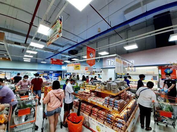 Bác tin đồn đóng cửa siêu thị Co.op Mart, Co.opXtra - Ảnh 1.