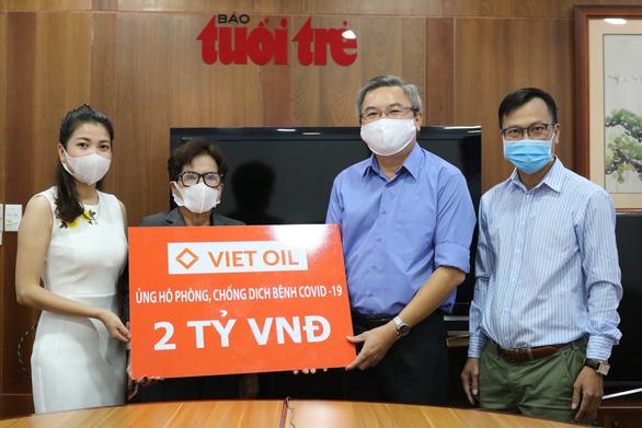 Bạn đọc đã chung tay cùng Tuổi Trẻ 14,5 tỉ đồng: Mỗi người góp một ít, Việt Nam sẽ thắng COVID-19 - Ảnh 1.