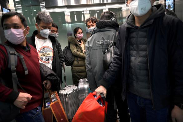 Bắc Kinh chống nhập khẩu COVID-19 ngược: buộc người đến từ Hàn, Nhật, Iran, Ý cách ly - Ảnh 1.