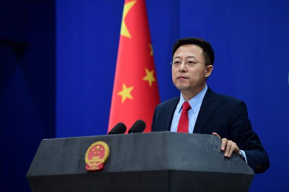 Bắc Kinh dọa trả đũa vì Mỹ 'trục xuất' nhà báo Trung Quốc - Ảnh 1.