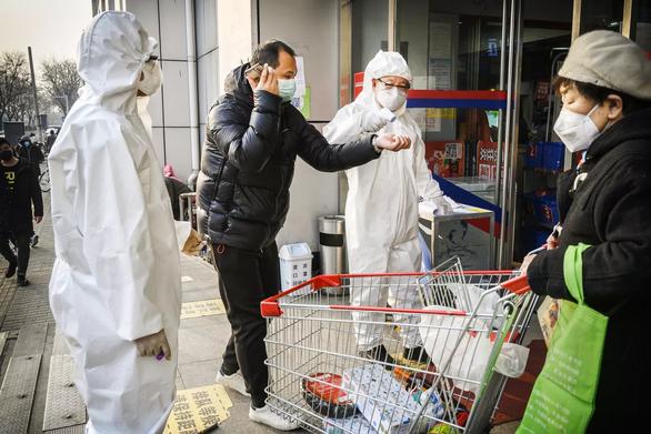 Vì sao Trung Quốc giảm kỷ lục số ca bệnh COVID-19? - Ảnh 3.