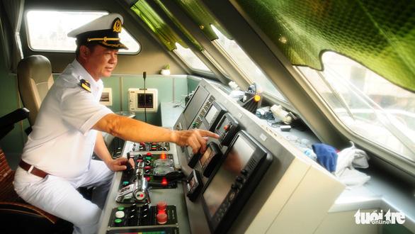 Đội tàu hai lần đón hàng không mẫu hạm Mỹ - Ảnh 3.
