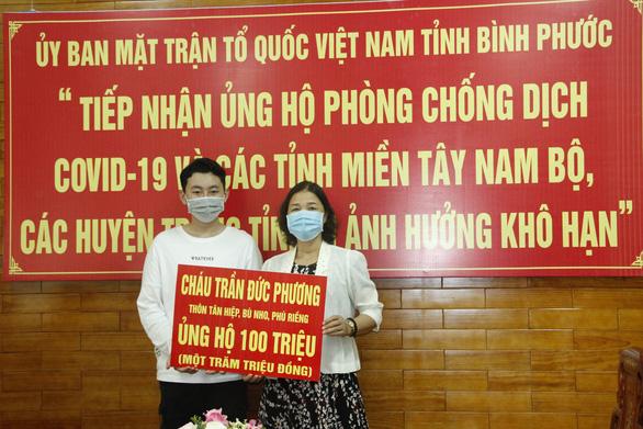 Hai học sinh đập heo đất ủng hộ 200 triệu phòng chống COVID-19 - Ảnh 1.