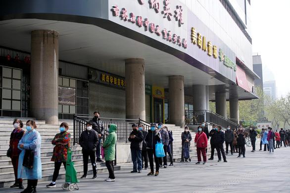 Trung Quốc ngăn được hơn 700.000 ca bệnh nhờ phong tỏa Vũ Hán? - Ảnh 2.