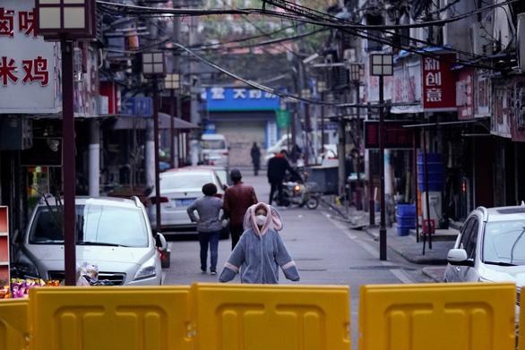 Bloomberg: Tình báo Mỹ kết luận Trung Quốc giấu dịch COVID-19 ở Vũ Hán - Ảnh 1.