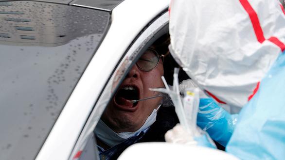 Hàn Quốc xét nghiệm 20.000 người mỗi ngày - Ảnh 1.