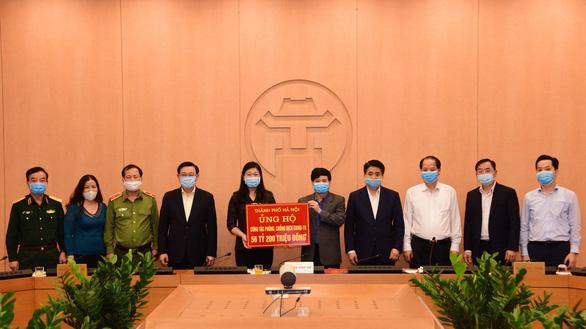 Ủng hộ một ngày lương, Hà Nội góp 56 tỉ vào quỹ phòng chống COVID-19 - Ảnh 1.