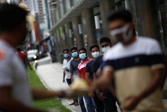 Ca nhiễm gần chạm mốc 4.000, Singapore tăng tốc bịt lỗ hổng ổ dịch nhập cư - Ảnh 1.