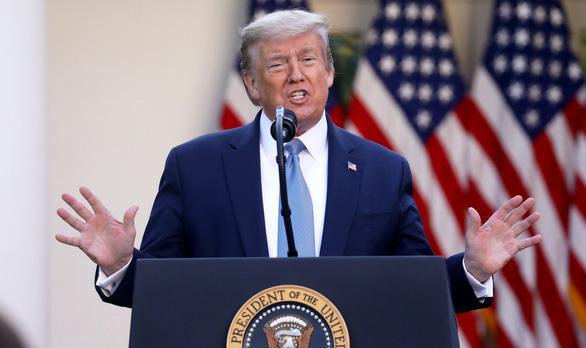 Tổng thống Trump nói Mỹ đã qua đỉnh dịch COVID-19 - Ảnh 1.
