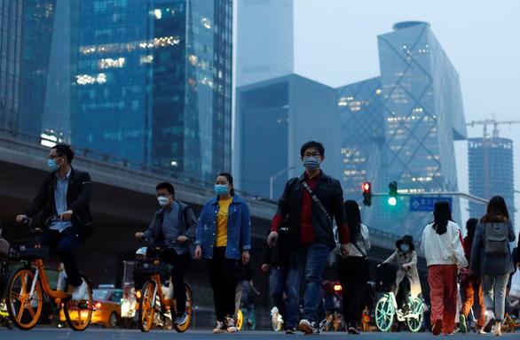 IMF: Đại dịch COVID-19 khiến kinh tế châu Á ngừng tăng trưởng - Ảnh 1.