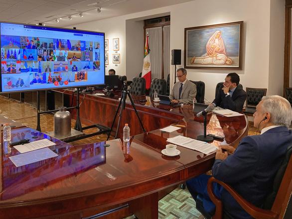 Họp trực tuyến Bộ trưởng Y tế G20: Việt Nam đề xuất biện pháp hợp tác chống dịch COVID-19 - Ảnh 1.