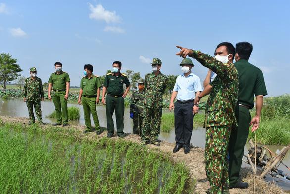 An Giang chi viện 92 cán bộ, chiến sĩ công an tỉnh về 22 xã biên giới phòng dịch COVID-19 - Ảnh 1.