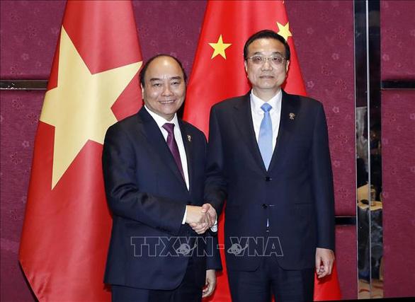 Trung Quốc đánh giá cao các biện pháp chống dịch COVID-19 của Việt Nam - Ảnh 1.