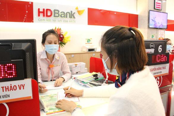 HDBank cộng lãi suất, miễn phí chuyển khoản nội mạng cho khách hàng Saigon Co.op - Ảnh 1.