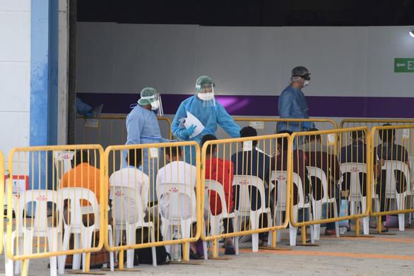 Singapore lập bệnh viện dã chiến hơn 4.000 giường, dùng nhiều robot - Ảnh 1.