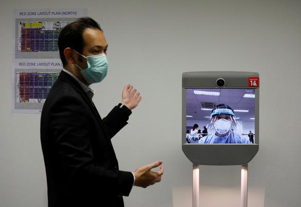 Singapore lập bệnh viện dã chiến hơn 4.000 giường, dùng nhiều robot - Ảnh 5.