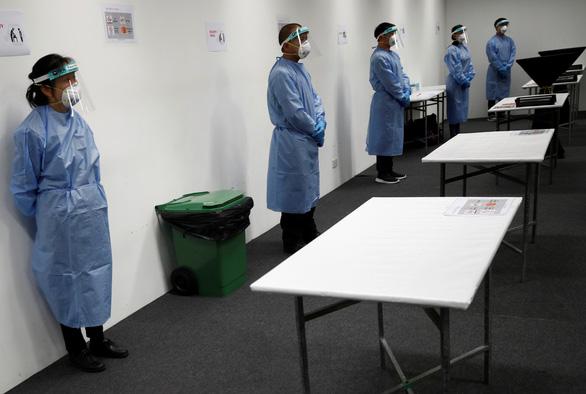 Singapore lập bệnh viện dã chiến hơn 4.000 giường, dùng nhiều robot - Ảnh 8.