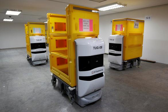 Singapore lập bệnh viện dã chiến hơn 4.000 giường, dùng nhiều robot - Ảnh 6.