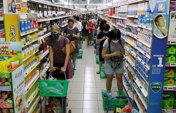 Singapore đóng trường học, công sở, thay đổi quan điểm về... khẩu trang - Ảnh 2.