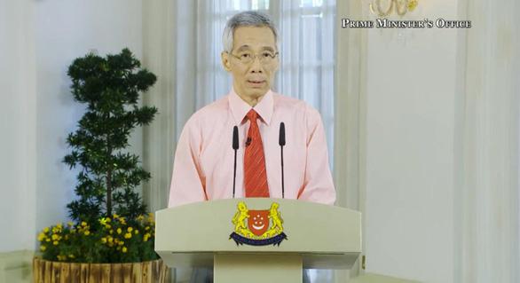 Singapore đóng trường học, công sở, thay đổi quan điểm về... khẩu trang - Ảnh 1.