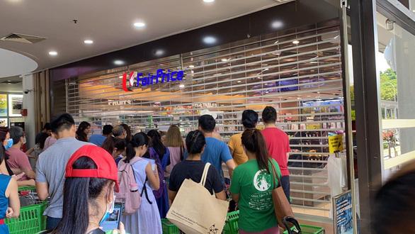 Singapore: từ hình mẫu đến hốt hoảng - Ảnh 1.