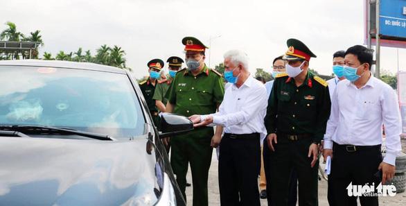 Vì sao Hải Phòng, Đà Nẵng cách ly tự trả phí với người về từ Hà Nội, TP.HCM? - Ảnh 1.