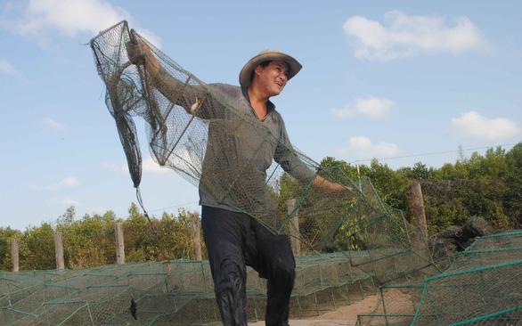 Xóm biển Khánh Hội sau 23 năm hứng cơn cuồng phong Linda - Ảnh 1.