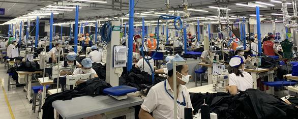 Thủ tướng đồng ý hạ tiêu chí cho doanh nghiệp vay gói 16.000 tỉ trả lương - Ảnh 1.