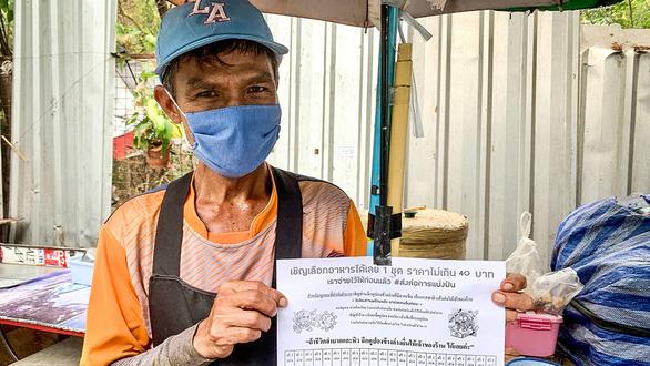 Trả trước tiền cơm cho người nghèo ở Thái - Ảnh 1.