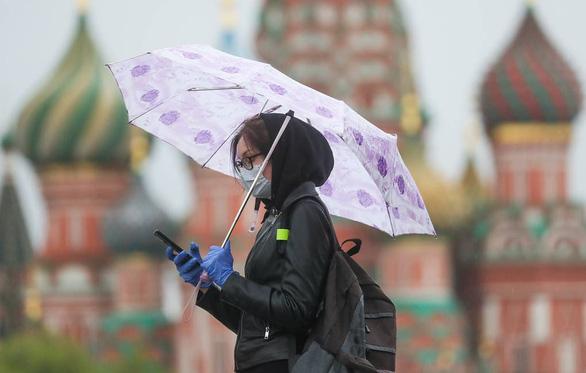 Tổng thống Putin tuyên bố kết thúc giai đoạn nghỉ làm ngồi nhà từ 12-5 - Ảnh 1.