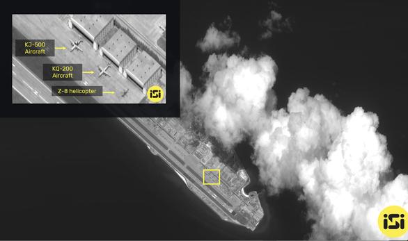 Việt Nam lên tiếng việc Trung Quốc đưa máy bay quân sự ra đá Chữ Thập - Ảnh 1.