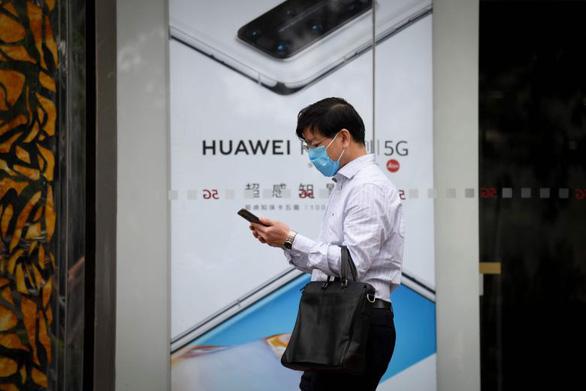 Trung Quốc đòi Mỹ ngừng đàn áp vô lý Tập đoàn Huawei - Ảnh 1.