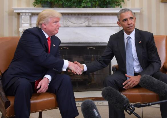 Vì sao ông Trump và ông Obama khẩu chiến? - Ảnh 1.