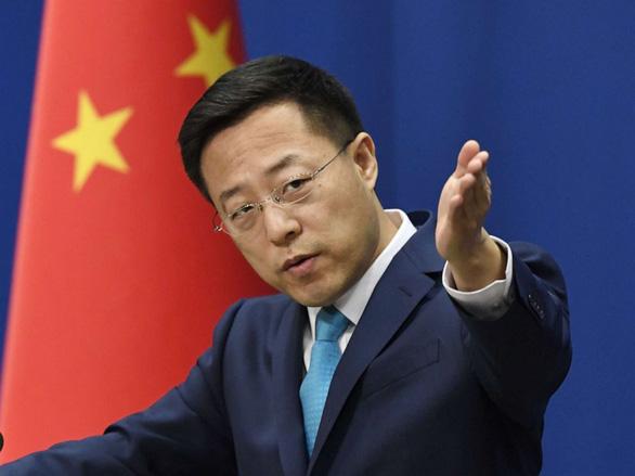 Trung Quốc tố Mỹ vu khống WHO để trốn trách nhiệm với COVID-19 - Ảnh 1.