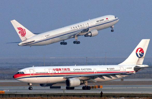 Mỹ yêu cầu 4 hãng hàng không Trung Quốc nộp lịch bay - Ảnh 1.