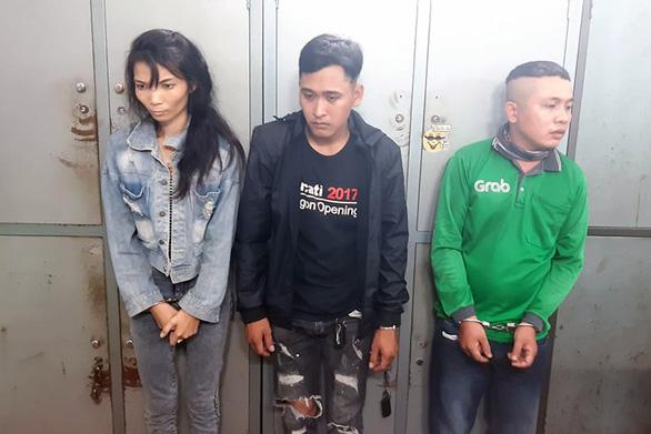 Triệt phá nhóm mua bán ma túy dùng vỏ bọc tài xế Grab - Ảnh 1.