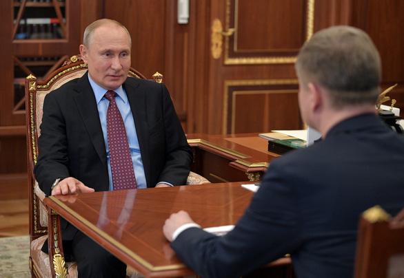 Ông Putin trở lại điện Kremlin sau thời gian dài làm từ xa  - Ảnh 1.