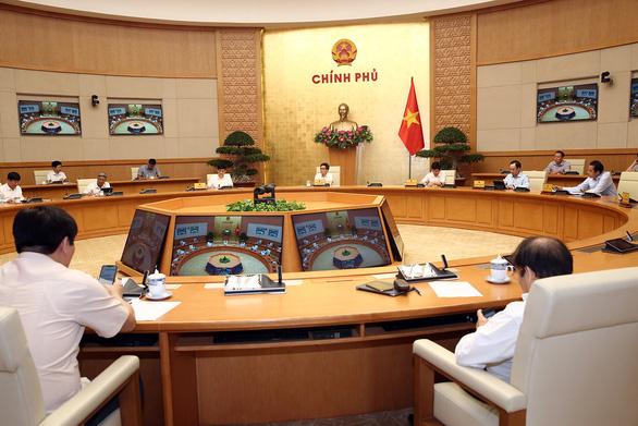 Chưa mở cửa đón du khách quốc tế vào Việt Nam - Ảnh 1.