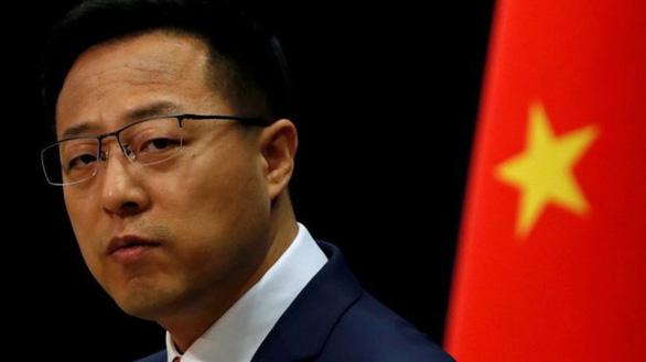 Sau ông Trump, đến phát ngôn viên Bộ Ngoại giao Trung Quốc bị Twitter gắn mác cảnh báo - Ảnh 1.