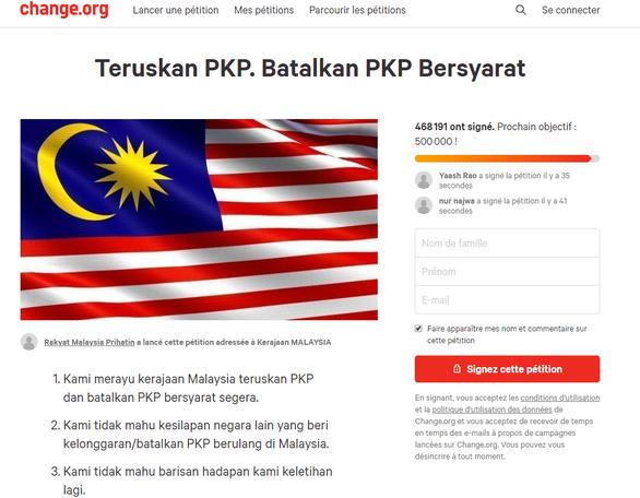 Nửa triệu người Malaysia ký tên đòi phong tỏa tiếp - Ảnh 1.