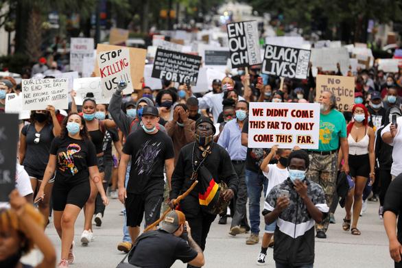 Minnesota huy động Vệ binh quốc gia, nhiều thành phố Mỹ áp lệnh giới nghiêm vì biểu tình - Ảnh 2.