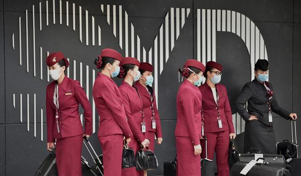 Thời dịch COVID-19, tiếp viên hàng không trông đẹp lạ - Ảnh 5.