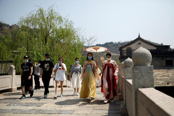 Hơn 23 triệu người Trung Quốc du lịch mỗi ngày kỳ nghỉ lễ lao động 1-5 - Ảnh 2.