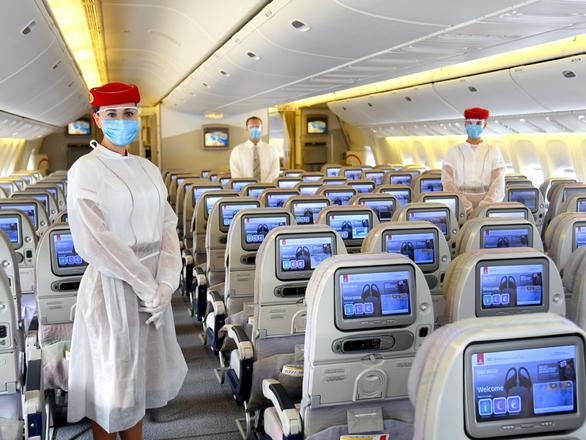 Thời dịch COVID-19, tiếp viên hàng không trông đẹp lạ - Ảnh 6.