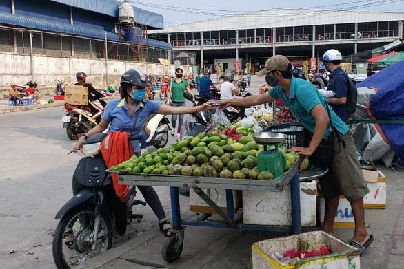 Vụ thu tiền bảo kê ở Đồng Nai: Hàng trăm tiểu thương phải chung tiền - Ảnh 1.