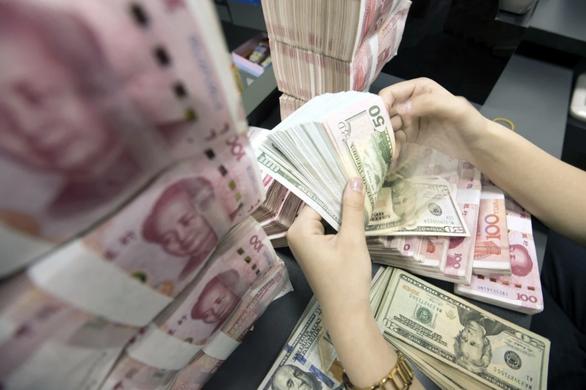 Trung Quốc có thể giảm lượng trái phiếu kho bạc Mỹ đang nắm giữ - Ảnh 1.